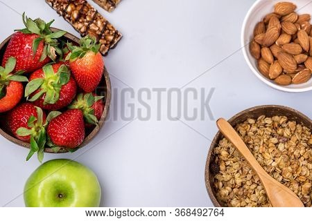 Coconut Bowls With Granola Or Muesli With Wooden Spoon Bowl With Ripe Strawberry And Almond Green Ap