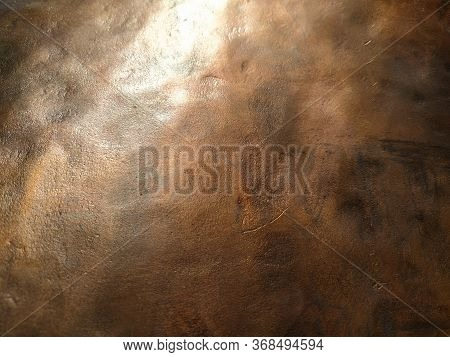 Copper Texture Background. Bronze Texture. Bent Metal With Dents. Close-up Of A Bronze Surface. A Re