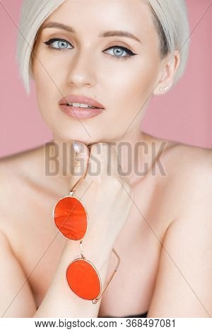 Stylish Blond Woman With Short Hair Cut With Trendy Red Sun Glasses. Beauty Blond Woman With Naked S