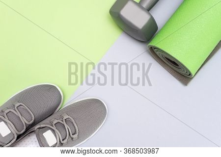 Yoga Mat, Sport Shoes, Apple, Bottle Of Water On Blue Wooden Background. Concept Healthy Lifestyle,