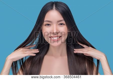Beautiful Woman Holding Her Healthy Hair And Feeling Amazing