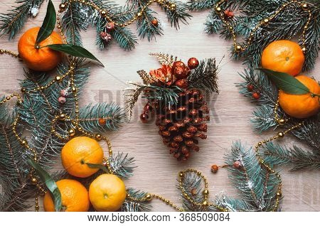 Christmas Background With Tangerines, Fir Branches, Rowan Berries And Fir Cone In Snow. Winter Holid