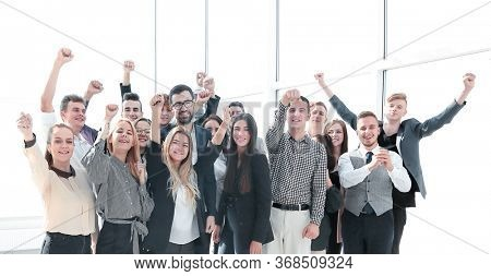 group of ambitious young people standing in a new office