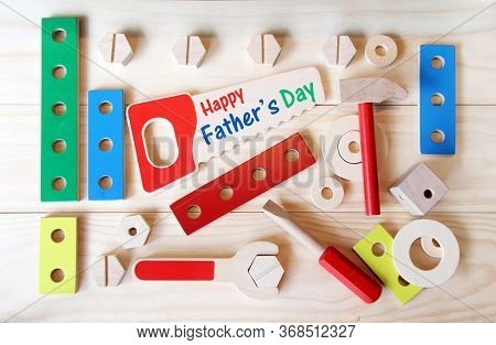 Happy Father's day tools. Wooden toys, including a hammer, a saw, a wrench and a screwdriver.