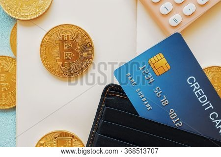 Business Finance Object And Technology Concept. Credit Card Bitcoin Calculator And Notebook On Paste