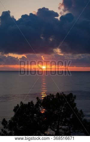 Sunset At Mediterranean Sea. Orange Cloudy Sky At Sundown. Mediterranean Sea At Nightfall. Beautiful
