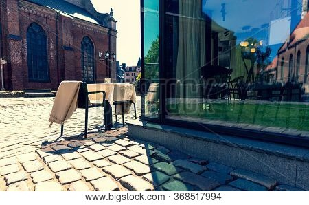 Restaurant Table In The Empty City Of Riga. The City Respected The Emergency During The Epidemic. Bu