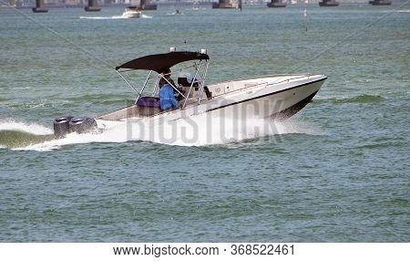 Outboard Engined Powered Motor Boat Speeding On Biscayne Bay Off Of Miami Beach,florida