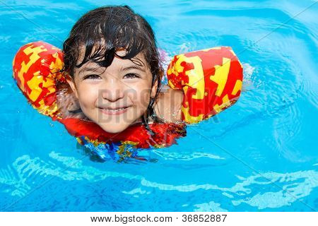 happy little girl in pool