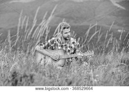 Hipster Musician. Inspiring Environment. Man Musician With Guitar On Top Mountain. Inspired Musician