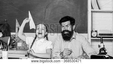 Teacher And Schoolgirl. Man Bearded Pedagogue And Pupil Having Fun. Developing Caring Learners Who A