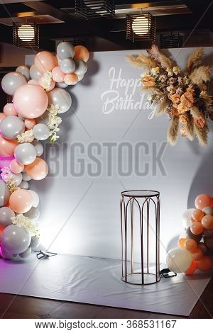 Birthday Photozone With Pampass Grass, Color Ballons And Glass Table.
