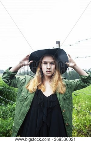 Young Pretty Blond Woman In Hipster Hat Posing In Fashion Dress Outside In Green Country Rancho, Lif