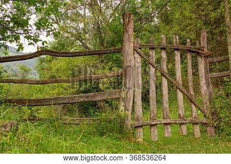 Wooden Fence Of A Mountain Village Garden In Romania. Outdoors Traditional Village Architecture.