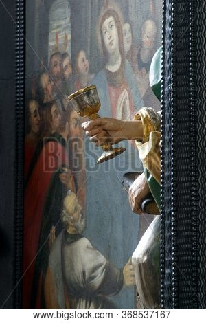 ZAGREB, CROATIA - MAY 16, 2013: The Chalice symbol of St. John the Evangelist, altar of the Holy Spirit in the Church of Saint Catherine of Alexandria in Zagreb, Croatia