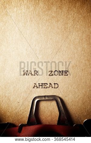 War zone ahead text written on a paper.