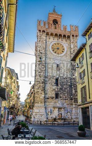 Brescia, Italy, September 11, 2019: Torre Della Pallata Brick Medieval Clock Tower Building With Mer