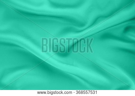 The Texture Of Draped Silk Fabric. Biscay Green, Cyan, Quiet Wave Background. Trend Colors Concept.