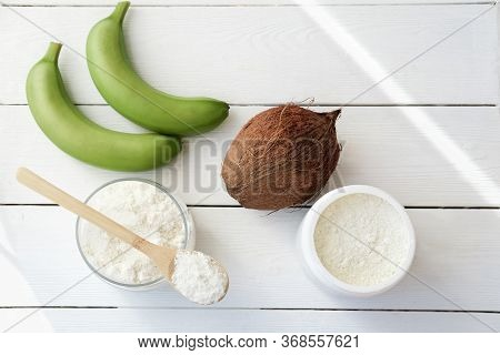 Green Bananas And Banana Flour. Coconut And Coconut Flour In A Jar. Gluten Free Low Carb Plant Flour