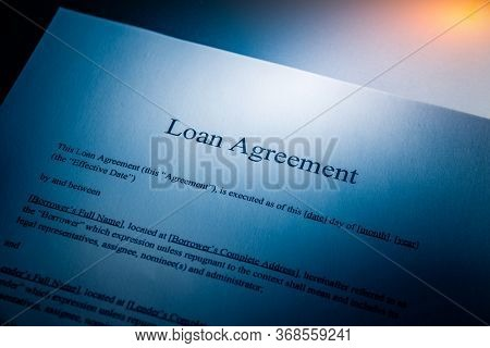 loan agreement in a dark light, blue toned images.