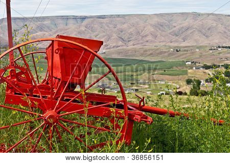 Farm Equipment  In Front Of Vista Of Valley.