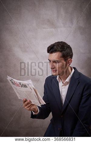 Man Reading A Fake News