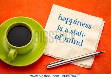 happiness is a state of mind inspirational reminder - handwriting on a napkin with a cup of coffee, personal development, mindset and attitude concept