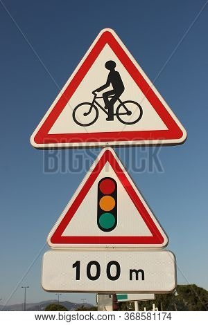 Road Sign For Cyclists Mounted On The Road. Traffic Light After A Hundred Meters. A Reminder For Cyc