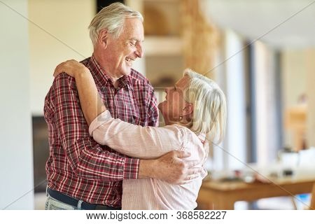Senior couple smilingly welcomes each other while meeting or getting to know each other