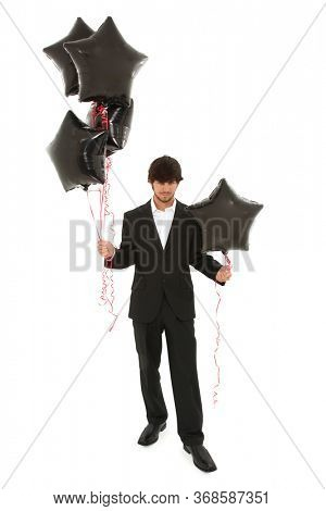 Handsome Young Man in Suit with Black Balloons over white with Clipping Path