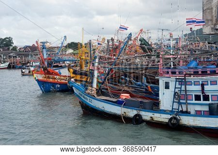 Rayong,thailand-february 8,2013: A Group Of Fishing Boats Moored In The Harbor To Avoid The Monsoon