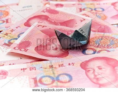 Chinese Yuan Background And Origami Ship From The Yuan