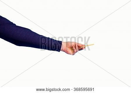 Male Hand Holding A Yellow Credit Card On A Blue Background