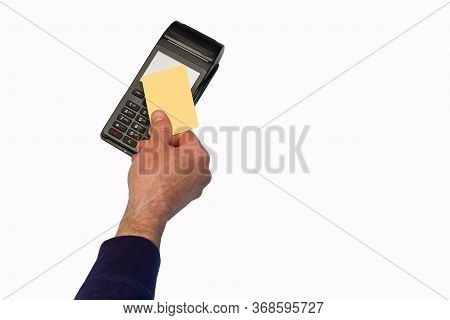 The Hand Holds A Credit Card On The Payment Terminal. Isolated On White Background