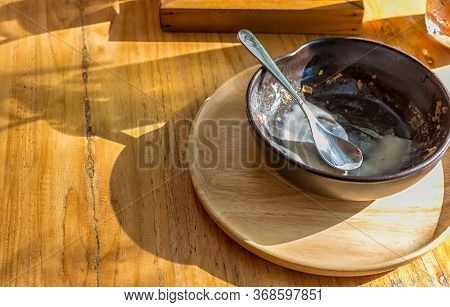 After Sweetmeat With Empty Bowl On Wood Table