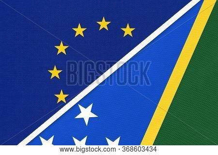 European Union Or Eu And Solomon Islands National Flag From Textile. Symbol Of The Council Of Europe