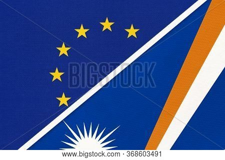 European Union Or Eu And Marshall Islands National Flag From Textile. Symbol Of The Council Of Europ