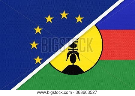 European Union Or Eu And New Caledonia National Flag From Textile. Symbol Of The Council Of Europe A
