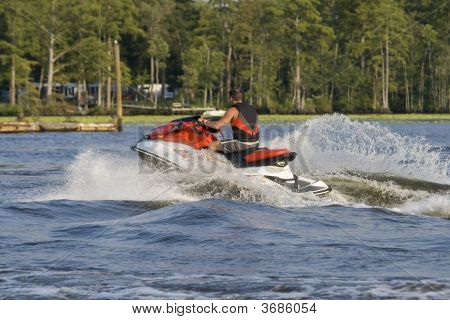 Man Riding Wave Runner In A River