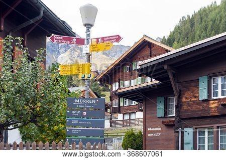 Lauterbrunnen, Switzerland - October 2019: Visitor Direction Signpost At Murren Mountain Village Sit