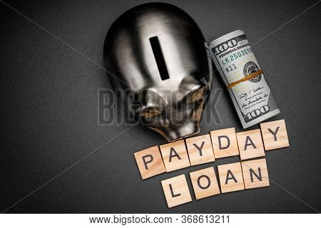 payday loan inscription on wooden cubes.