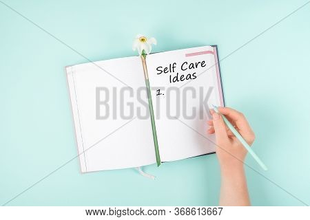 Self Care, Wellbeing Ideas, Holistic Set Of Self-care Activities Concept With Open Notebook, Flower