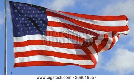 American Usa Flag On A Flagpole Waving In The Wind. Usa Flag Waving United States Of America Flag Fl