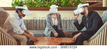 Business People Working With Virtual Reality Glasses During A Business Meeting. Multiethnic Team Usi
