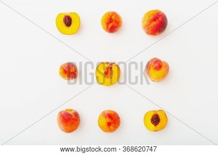 Peaches And Peach In Halves On White Wooden Background. Flat Lay Composition With Ripe Juicy Peaches