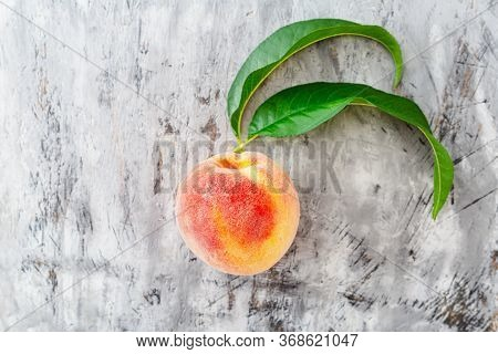 Peach With Leaf On Gray Concrete Background. Fresh Sweet Peach With Pitted. Top View Fresh Organic P
