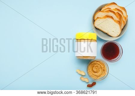 Mock Up For Peanut Butter, Creamy Peanut Paste.top View, Flat Lay. Process Of Cooking Breakfast On B