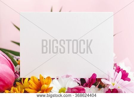 Flowers Mock Up Congratulation. Congratulations Card In Bouquet Of Flowers On Pink Background. White