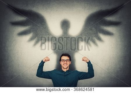 Confident Businessman Flexing Muscles Imagine Superpower. Guy Shows His Strength, Casting A Superher
