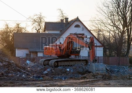 Excavator Demolishes An Old Wooden House In The Village For New Construction Project. Tearing Down A